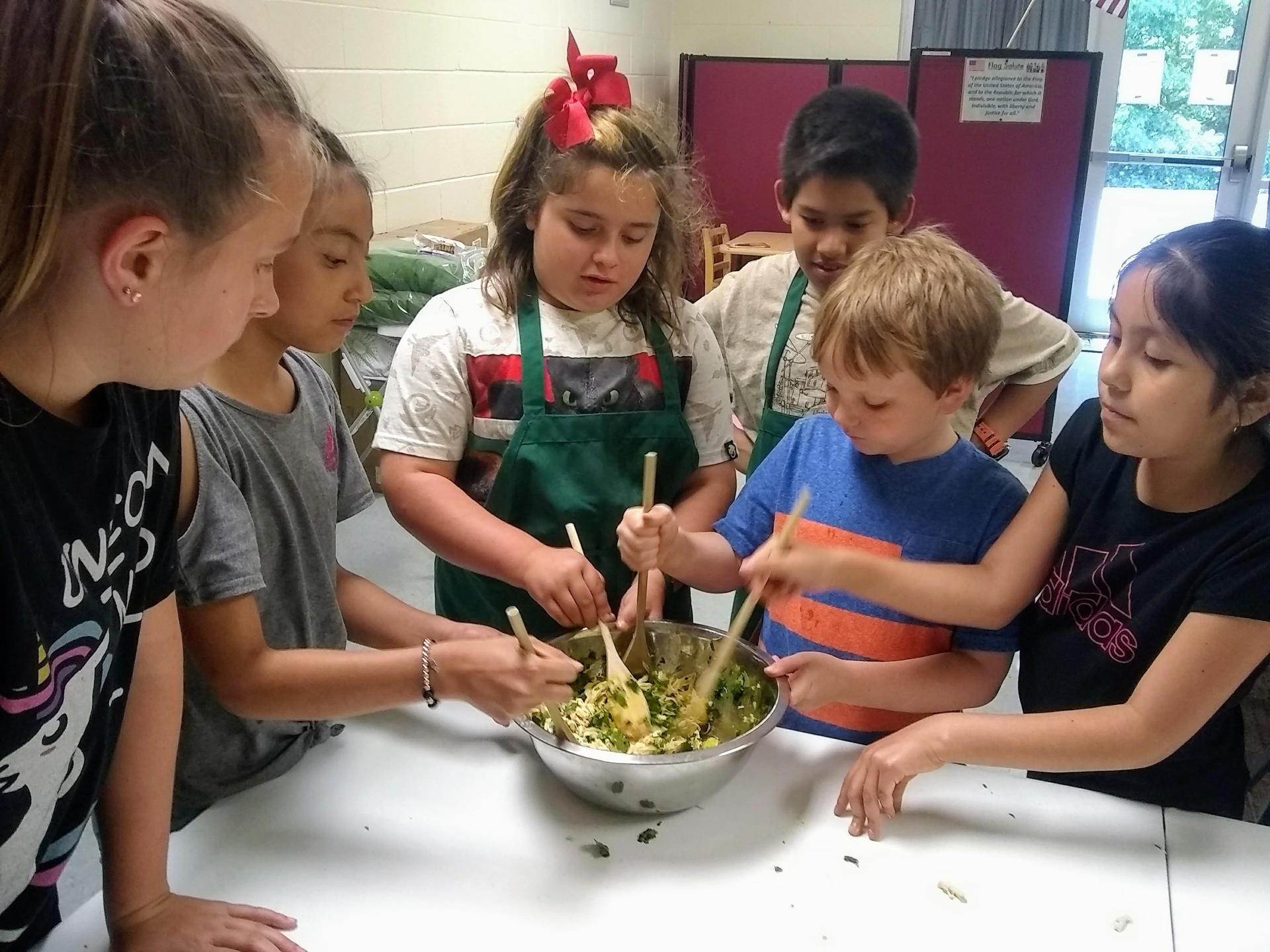 kids mixing salad