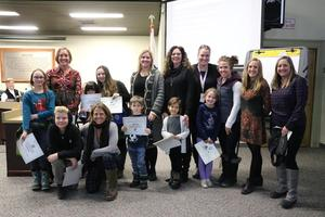 Juniper School receiving recognition at a board meeting