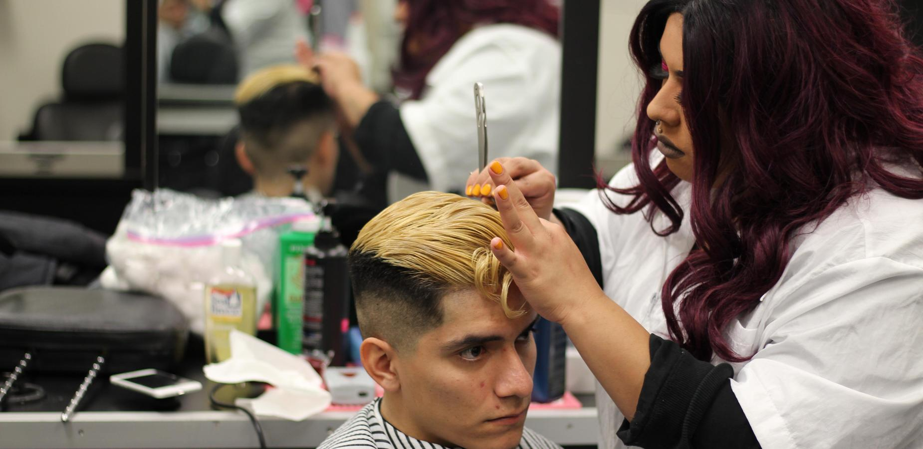 Barbering Students Working