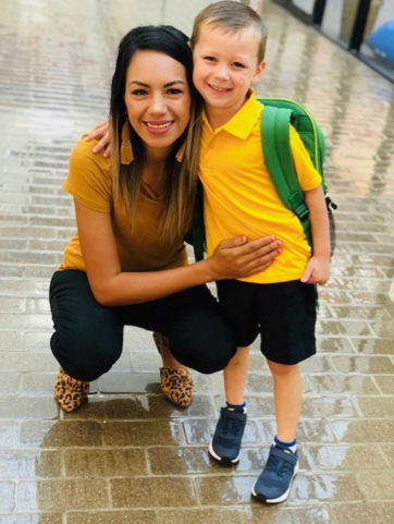 Art Teacher with a student in all yellow