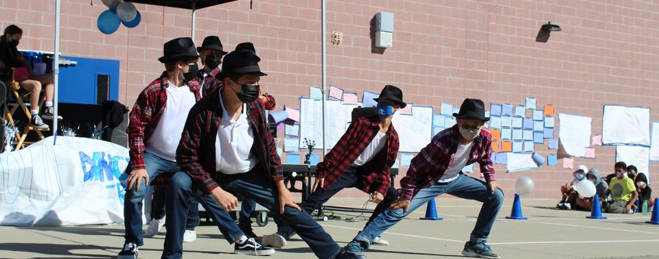 Students show off their smooth moves at line dance assembly.