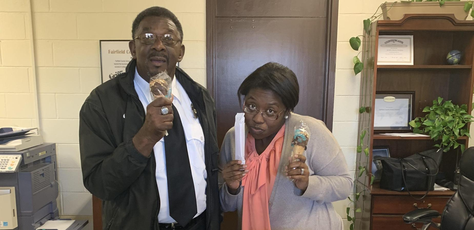 Mr. White and Mrs. Evans singing to the tune of sweet treats