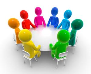 Pciture of a round table, with figures around them in different colors.