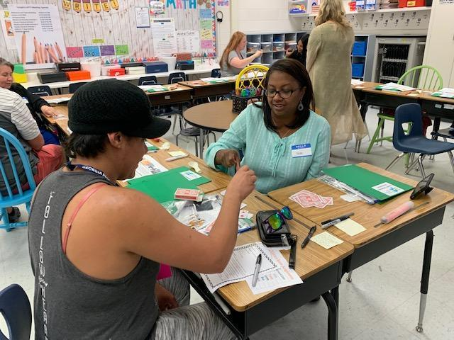 Parents playing educational game at APTT night