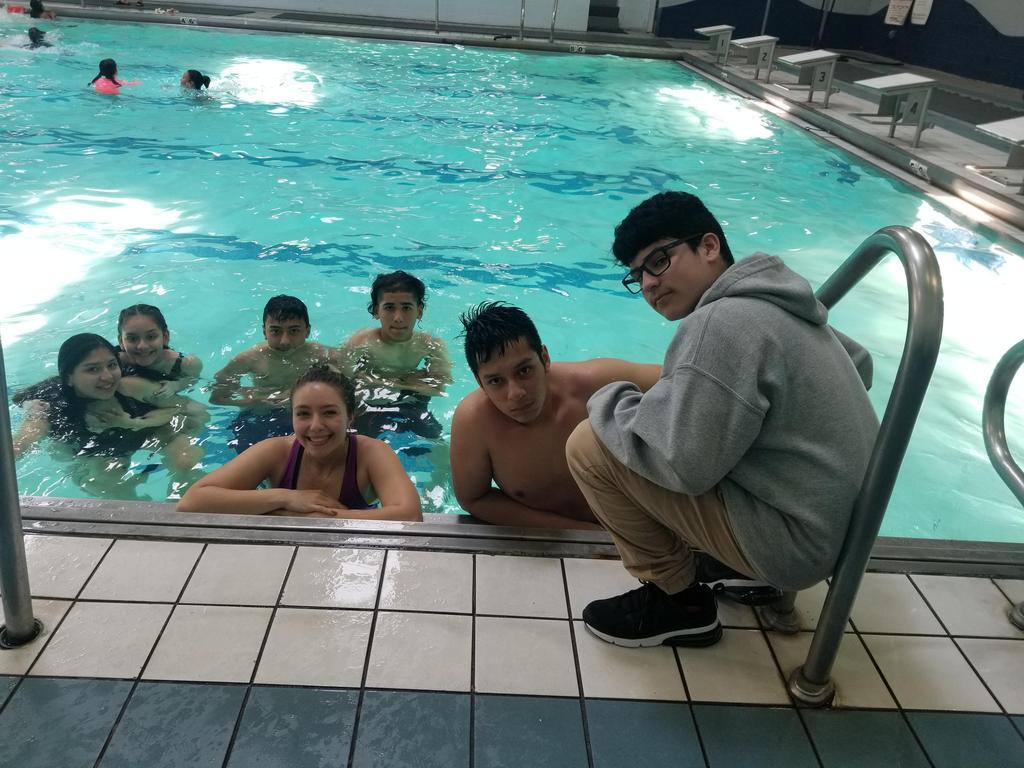 UHMS Regatta team with Ms. Velasquez in the pool