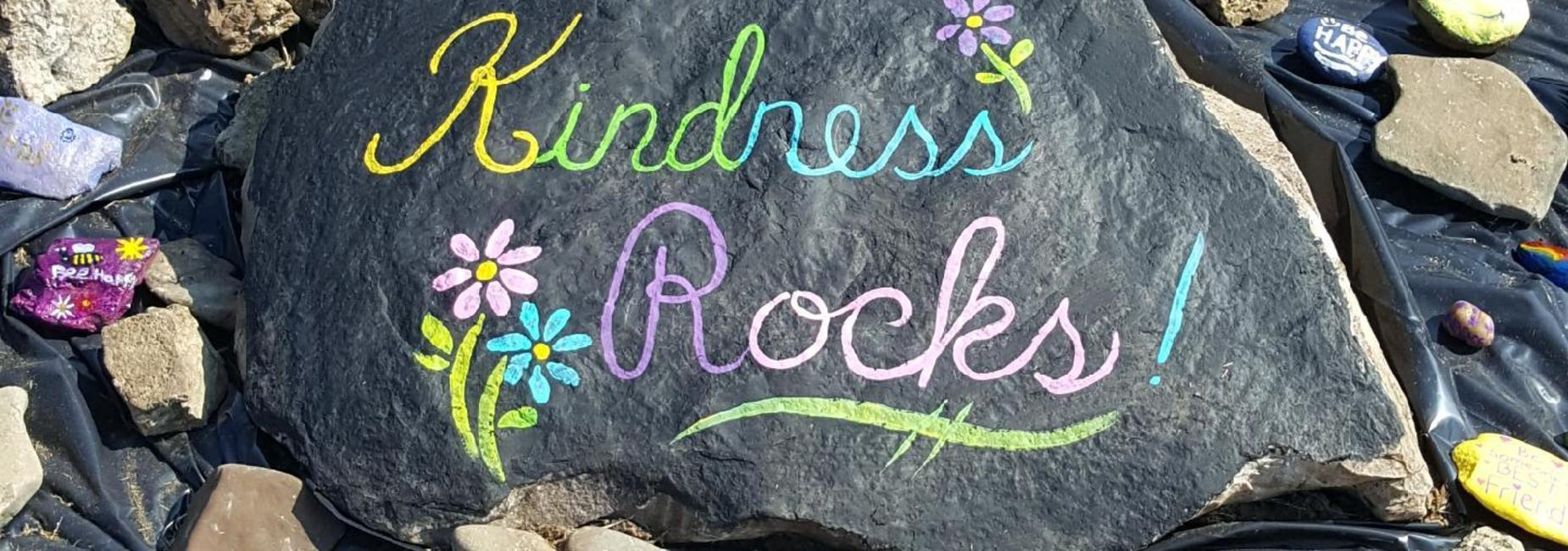 Large rock painted by the RVES staff for the centerpiece in the Kindness Rocks Garden project.