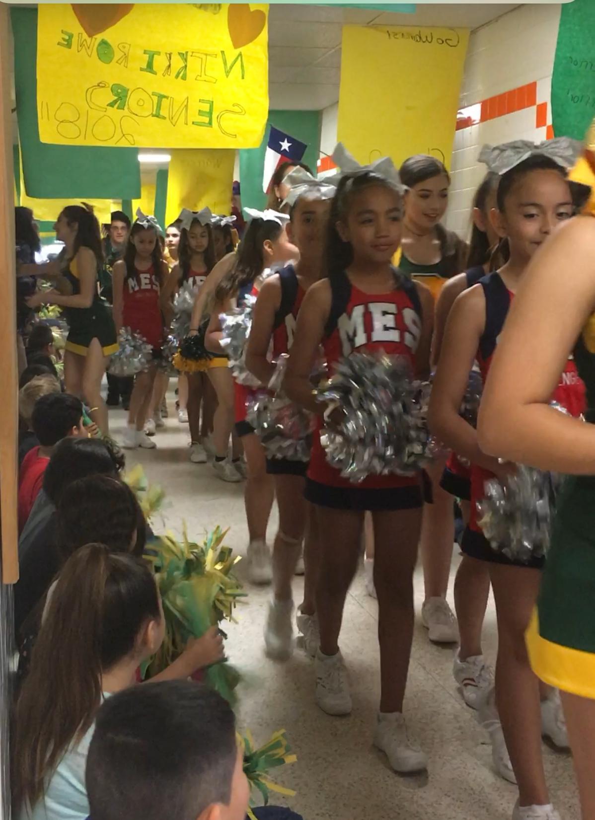 cheerleaders in hallway.
