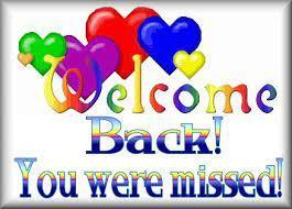 of a welcome back sign with different color hearts