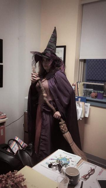 vp medina in with her witches broom and costumes