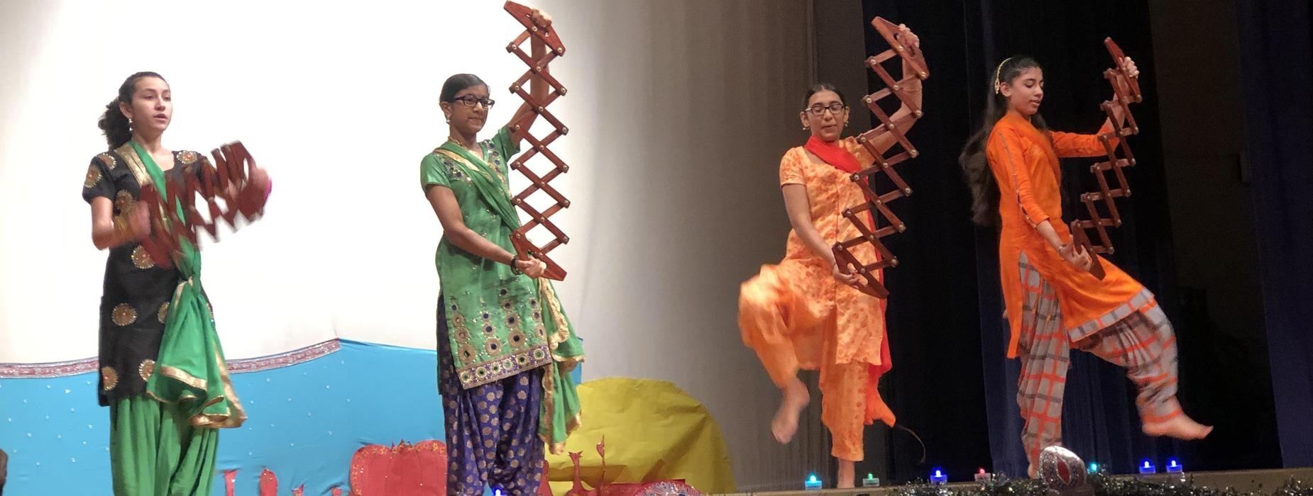 Students dance on stage.