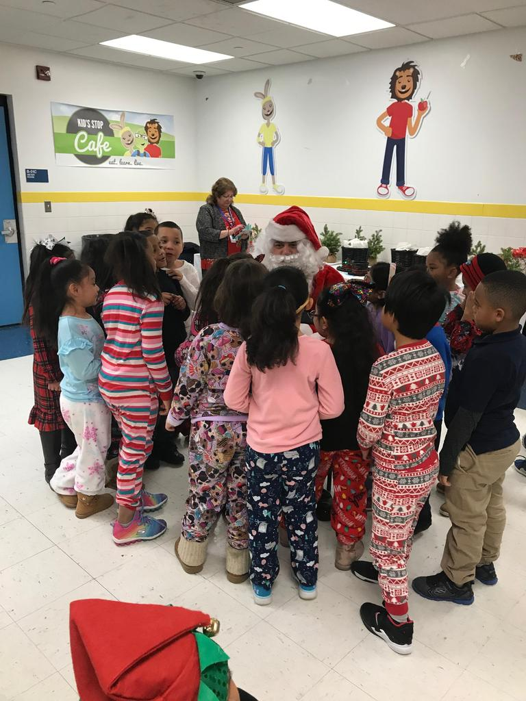 1st graders around santa