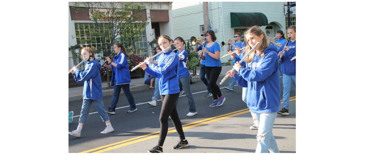 students marching playing flutes