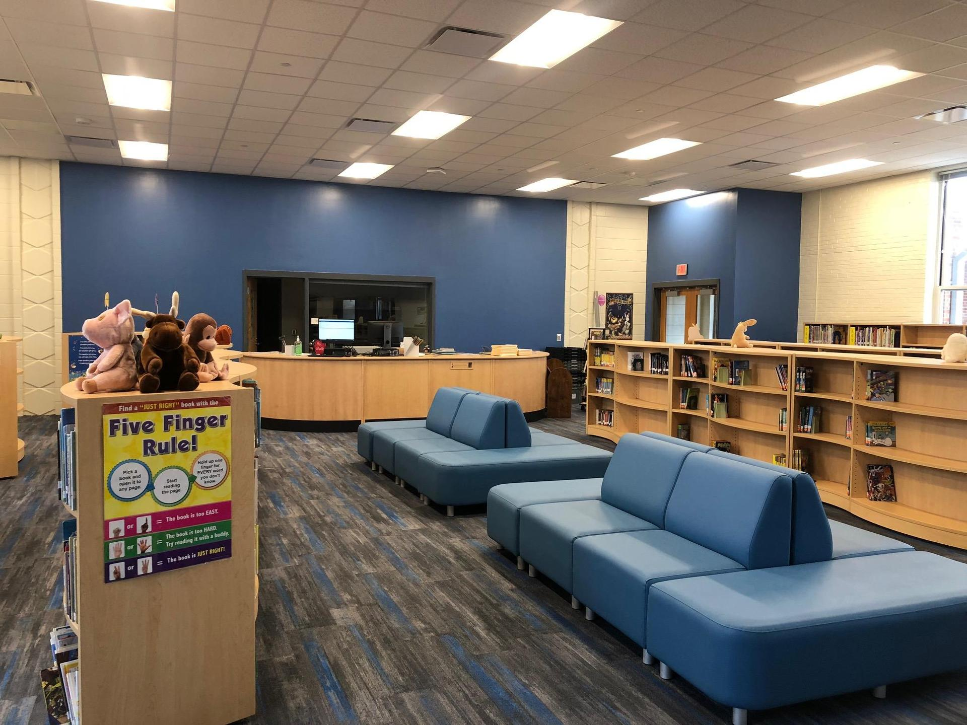 New Media Center checkout desk and comfortable seating for students
