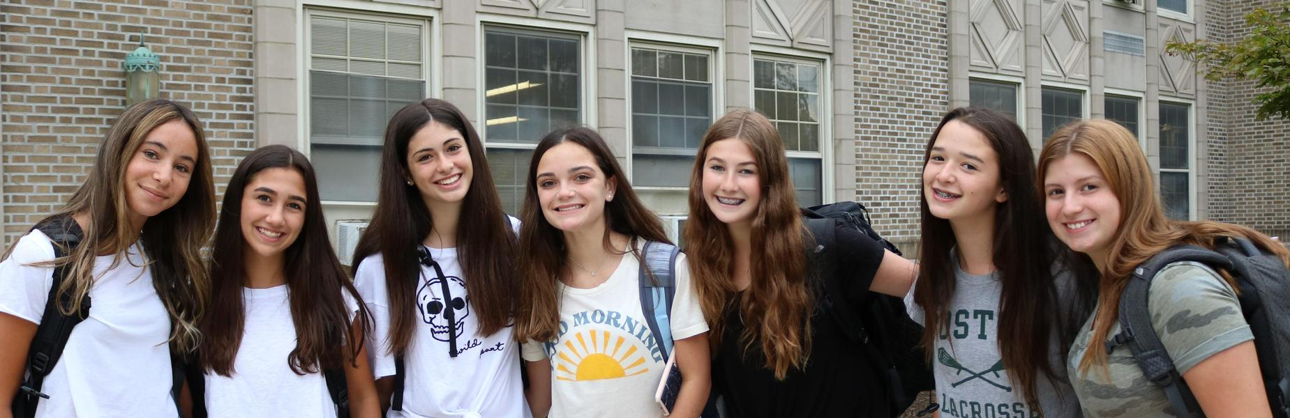 Photo of smiling RIS students on 2nd day of school.