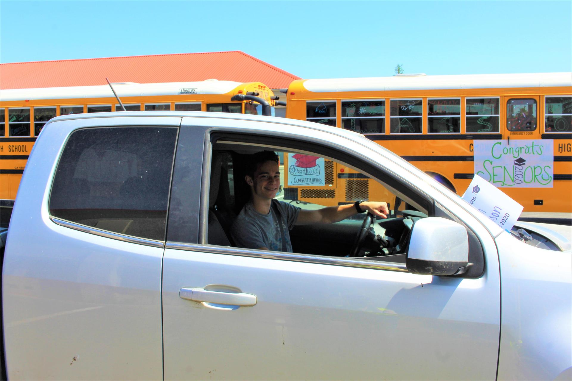 Dylan Tomlinson driving through