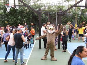 school mascot welcoming students and parents