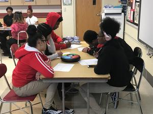 Students playing Simon game