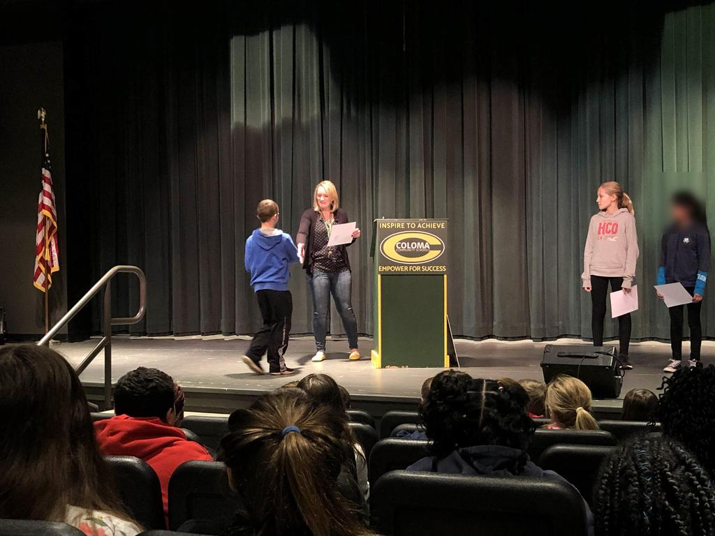 Mrs. Tremblay handing out an award