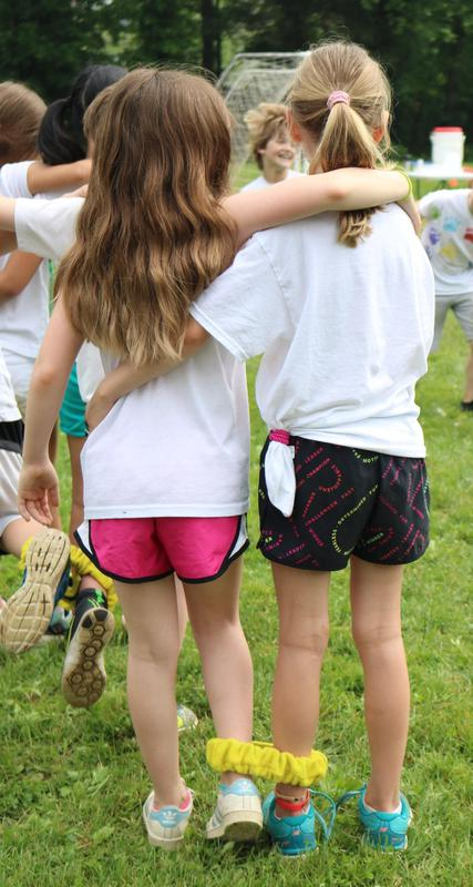 Two students at Washington School get ready for two-legged race during Field Day.