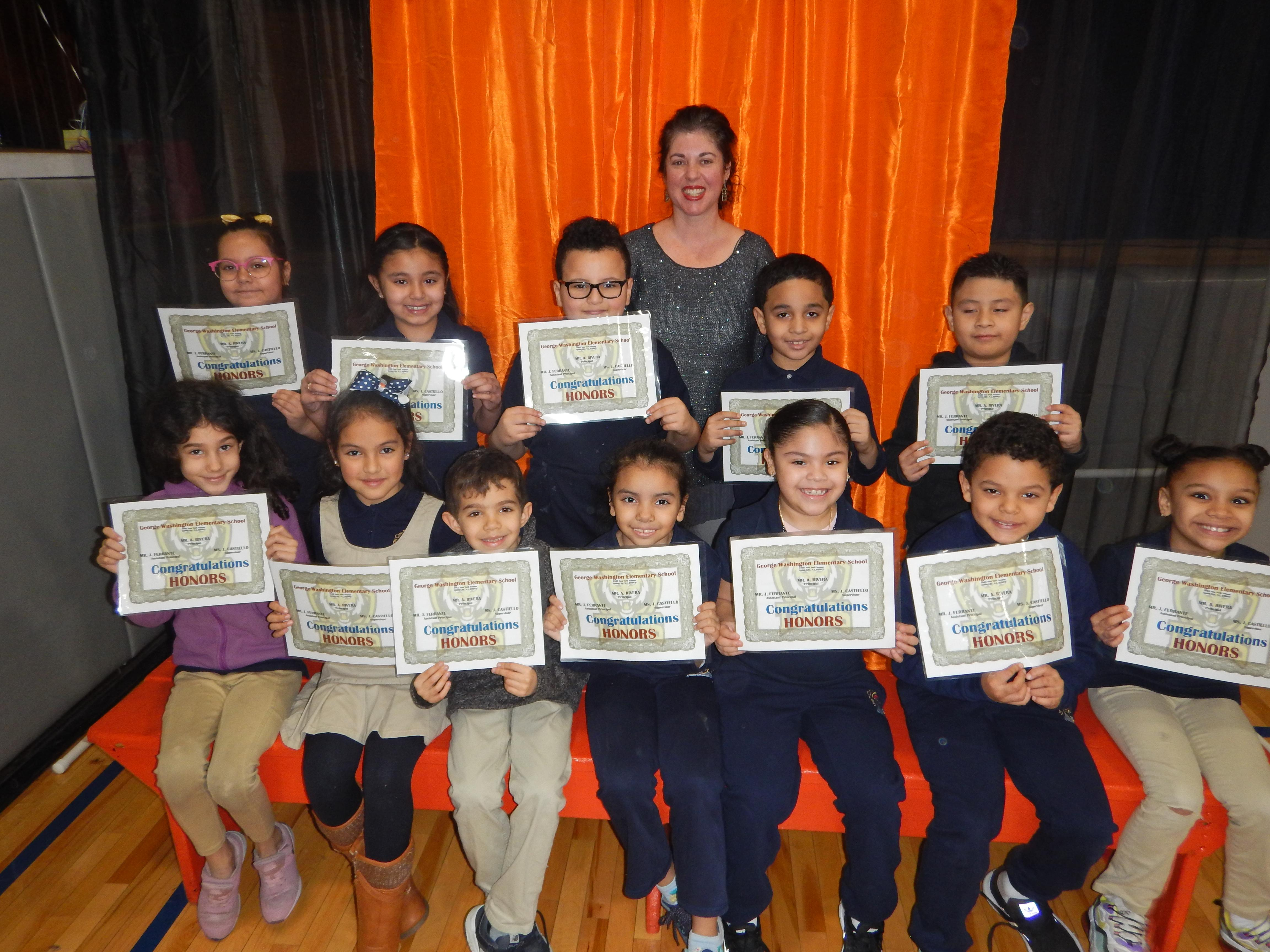 12 Honor Roll Students with their Teacher and certificates