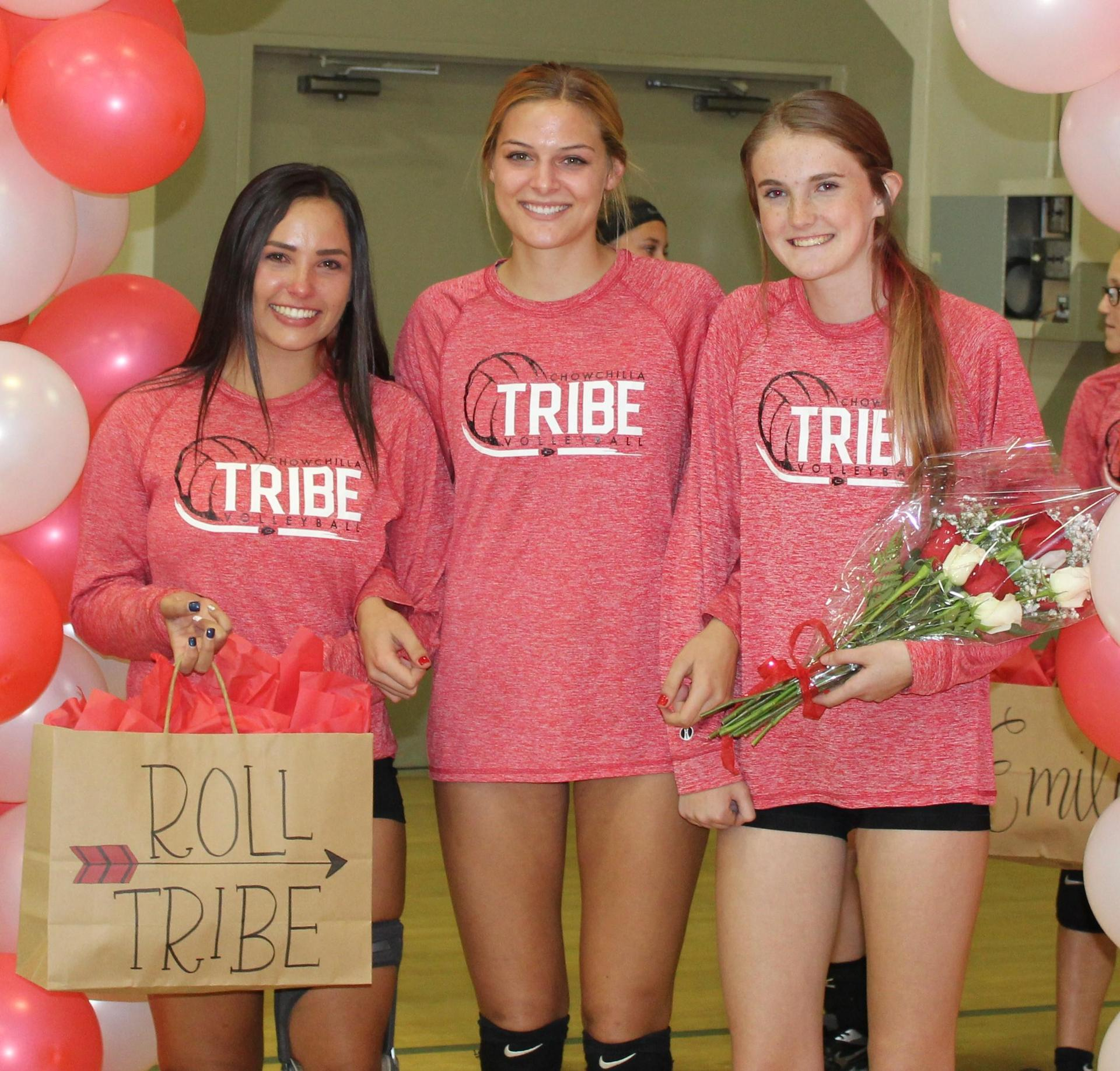 Sydney Alexander and Sami Eastton escort Kinsley Vlot on Volleyball Senior Night.