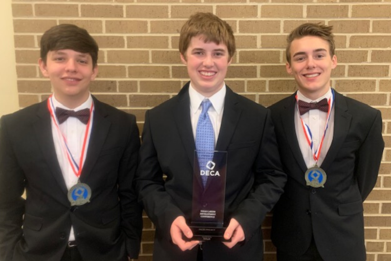 photo of three students advancing to the national competition