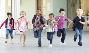 kids happily running out of school
