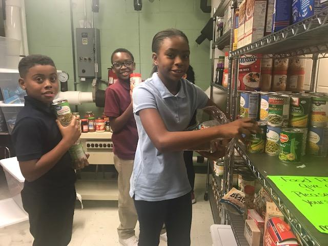 children helping unload food pantry delivery