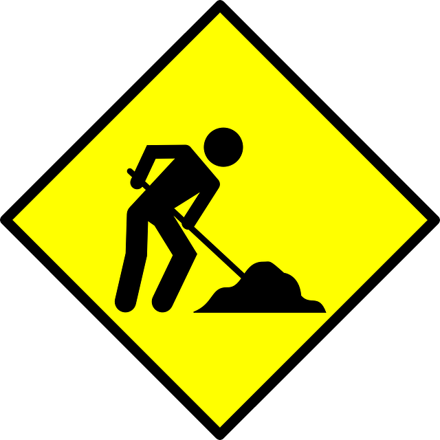 construction worker digging in a pile of dirt on a yellow diamond background frame