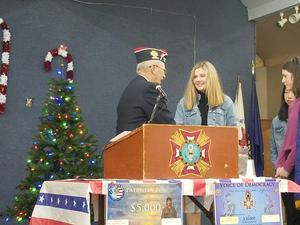 Setser receiving her certificate