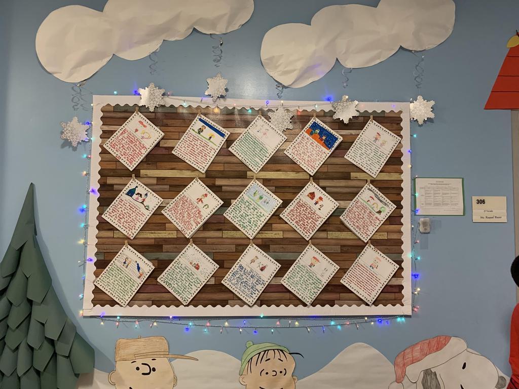 student writing display board