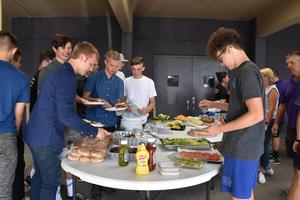 PC football players with their early dinner before a home game