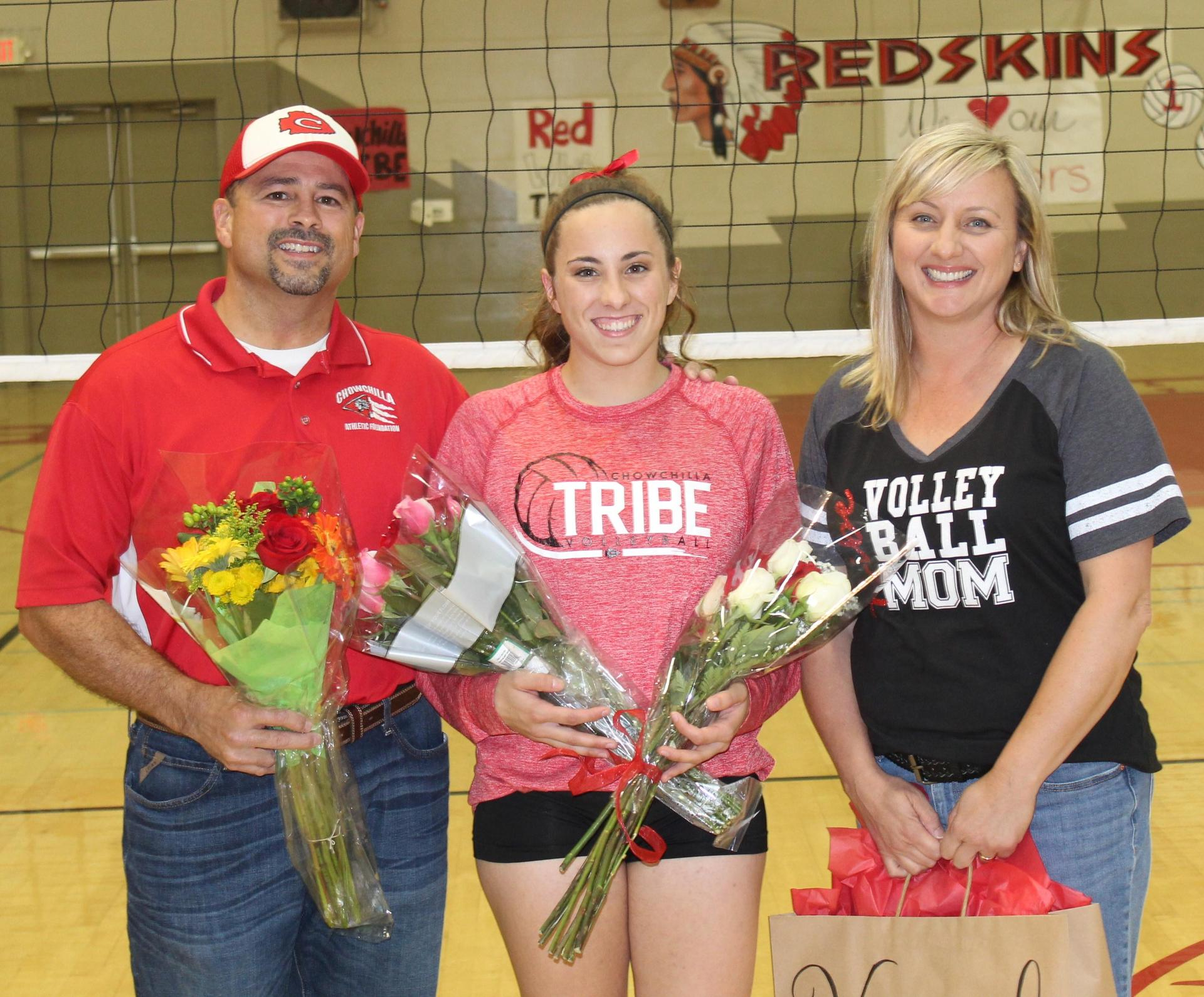 Hannah Mancebo and her parents on Volleyball Senior Night.