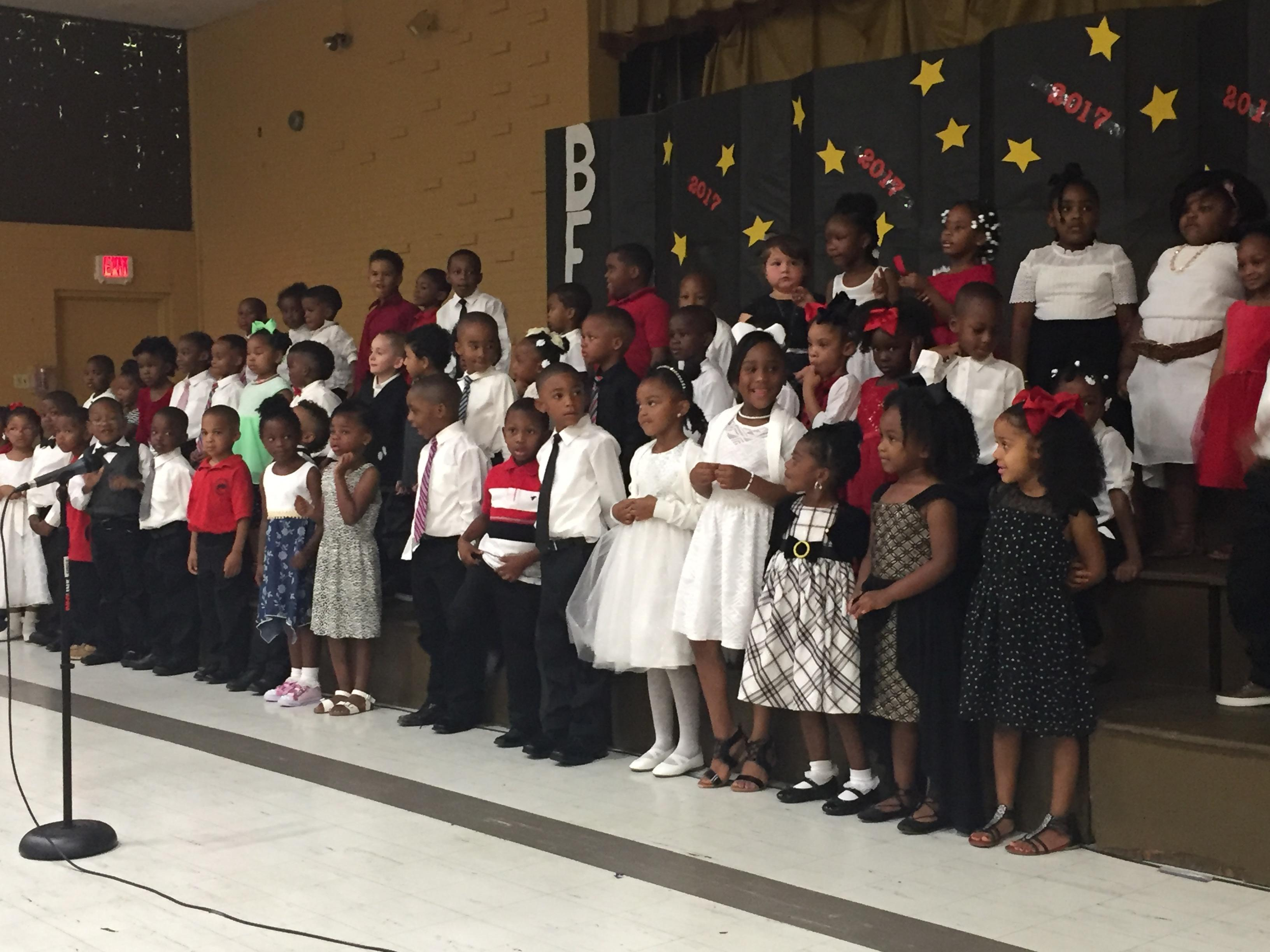 Photo of Pre Kindergarten and Kindergarten students at end of year awards program