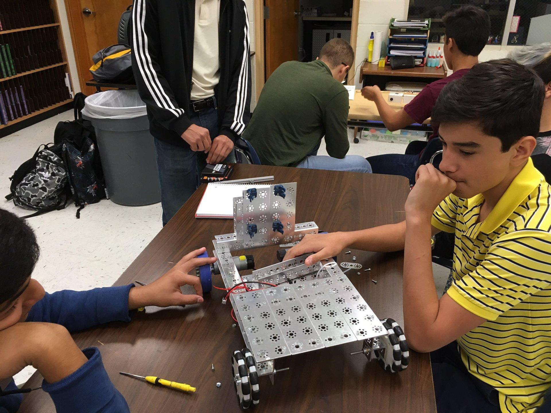 student sitting down thinking about how to design robot