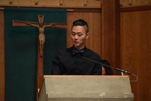 young man at pulpit