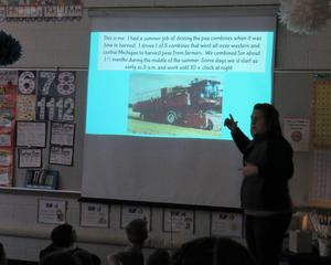Mrs. Gavette shows students how she used to drive a pea combine with the harvested product taken directly to Gerber for baby food.