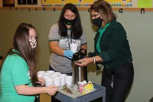 students serving coffee