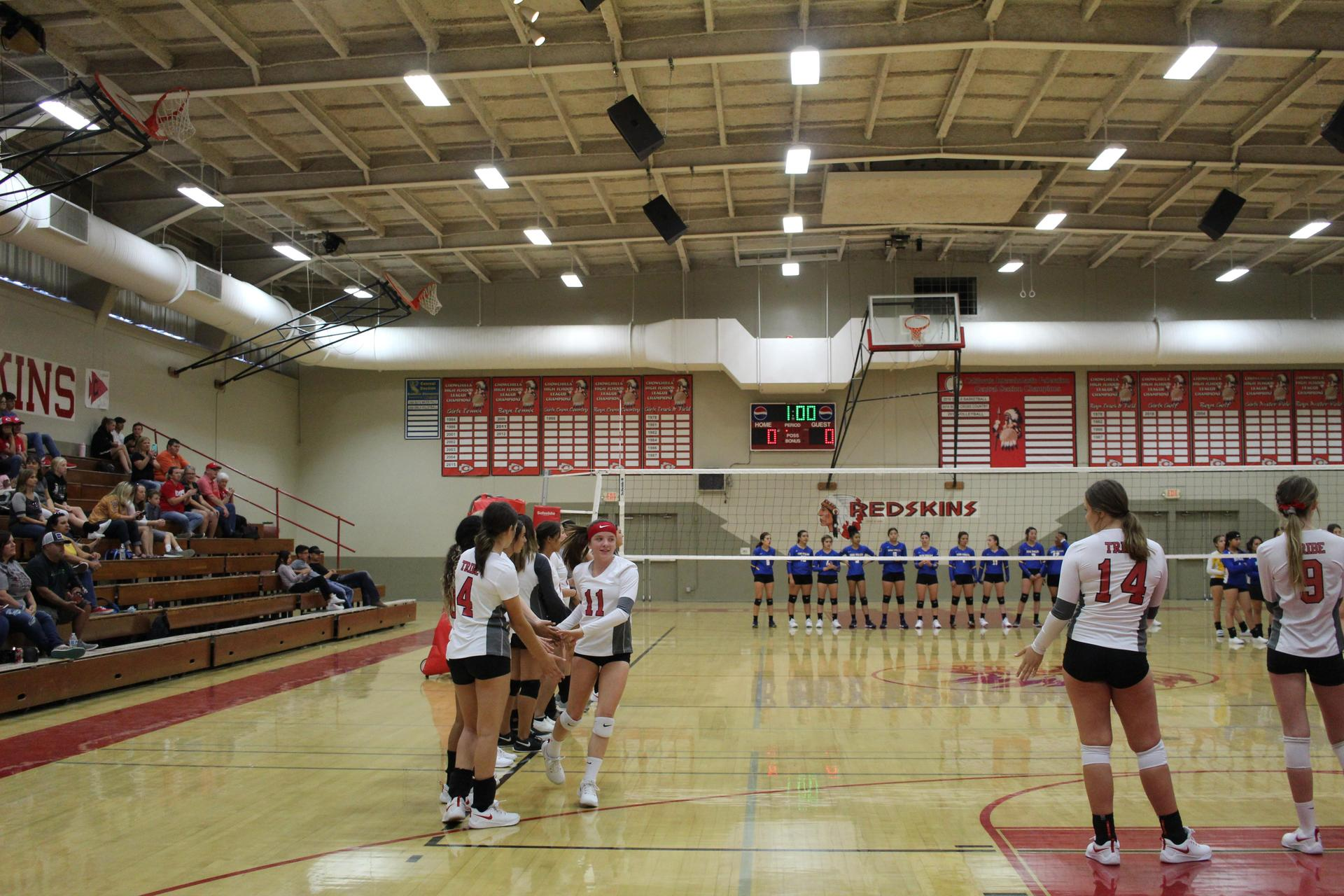 varsity girls playing volleyball against dos palosvarsity girls playing volleyball against dos palos
