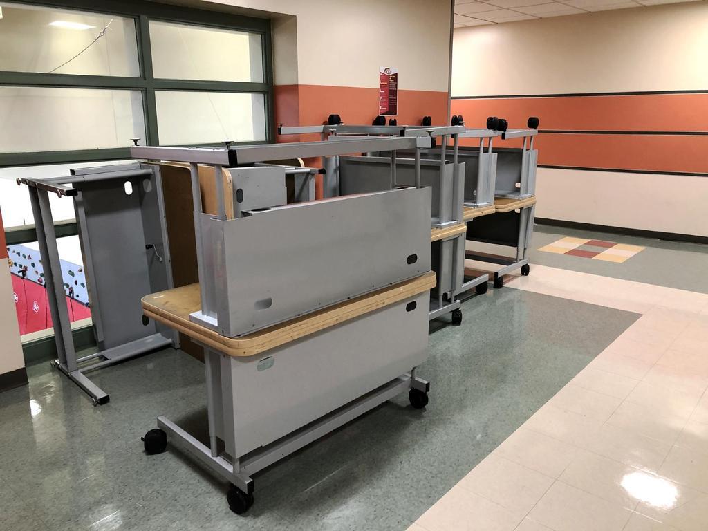 Desks stacked in a hallway