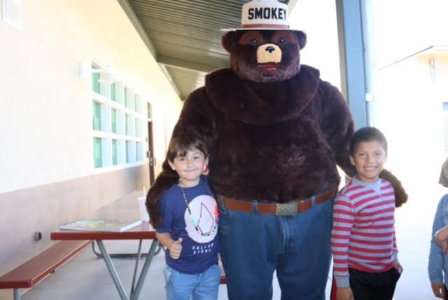 Second grade students with Smokey the bear.