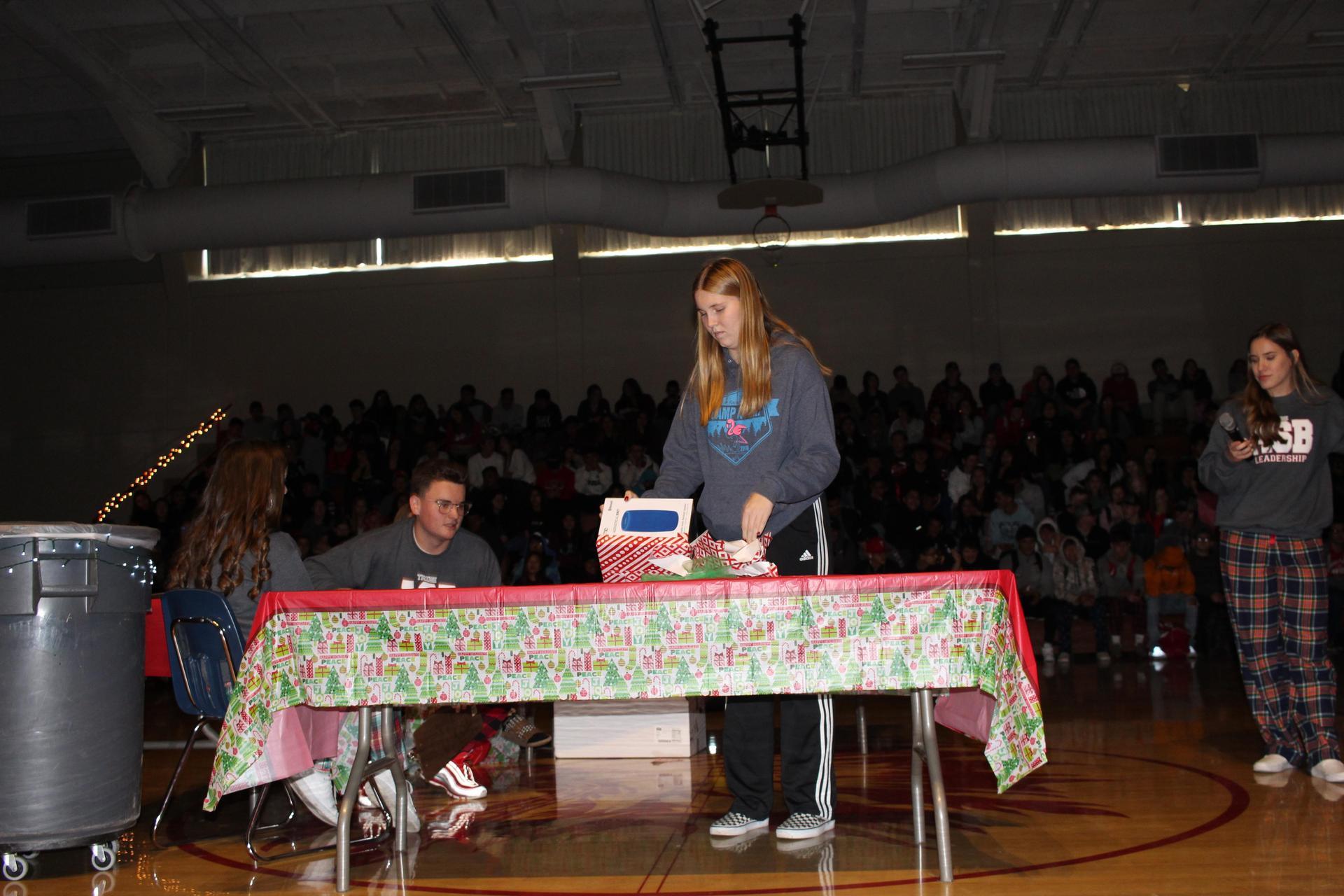 Zoe Bitter opening her gift
