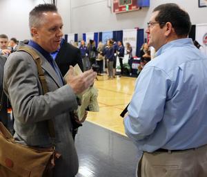 Steve Luker interviews candidate at last year's job fair