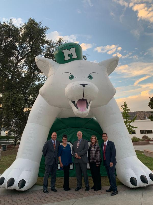 Monrovia Unified Board of Education members show their school pride while celebrating during the 2019-20 State of the Schools Address at Monrovia High School's Performing Arts Center on Oct. 16.