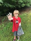 Students planting flowers and picking up trash before school starts.
