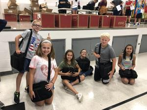 5th Grade Students show off their Chromebooks