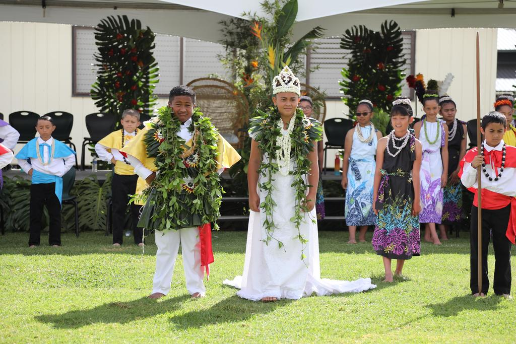 May Day Queen and King adorned with lei