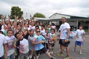 photo of Mr. Saldana with students after the color run.