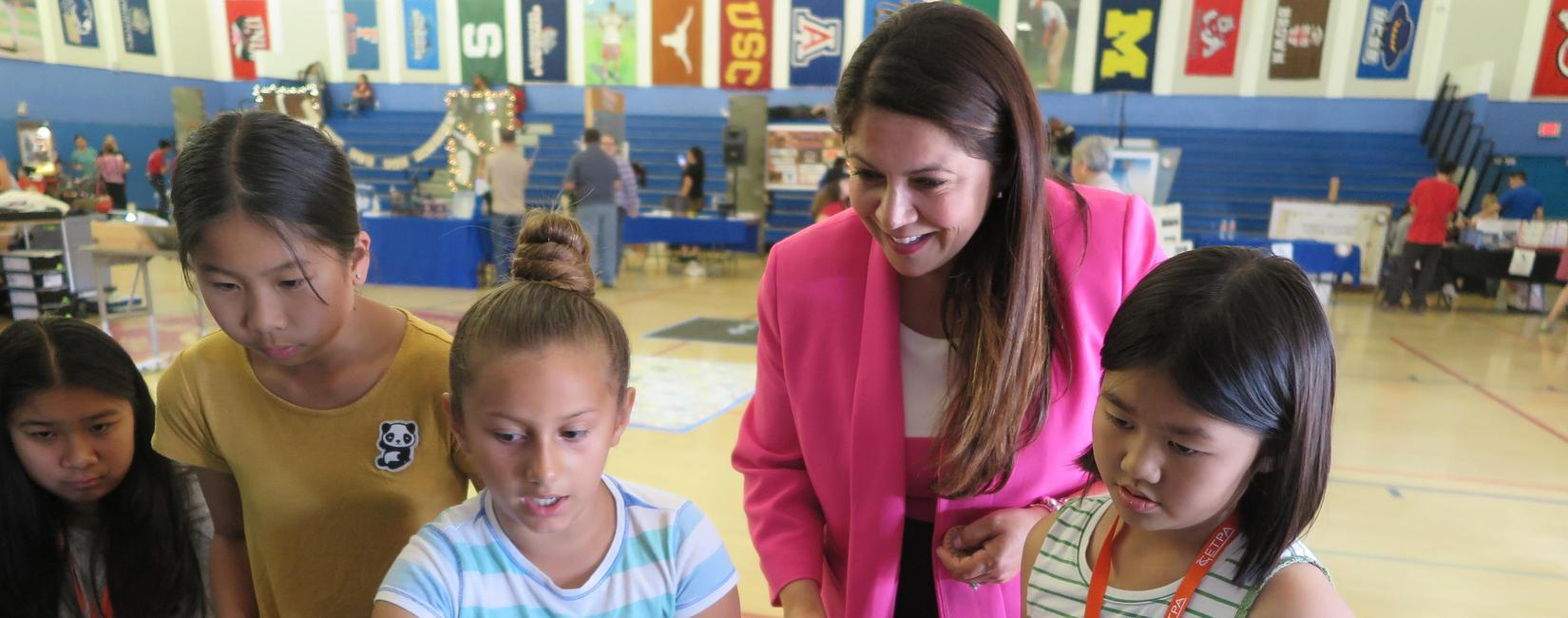 EMCSD Superintendent, Dr. Maribel Garcia interacting with students (photo from 2019)