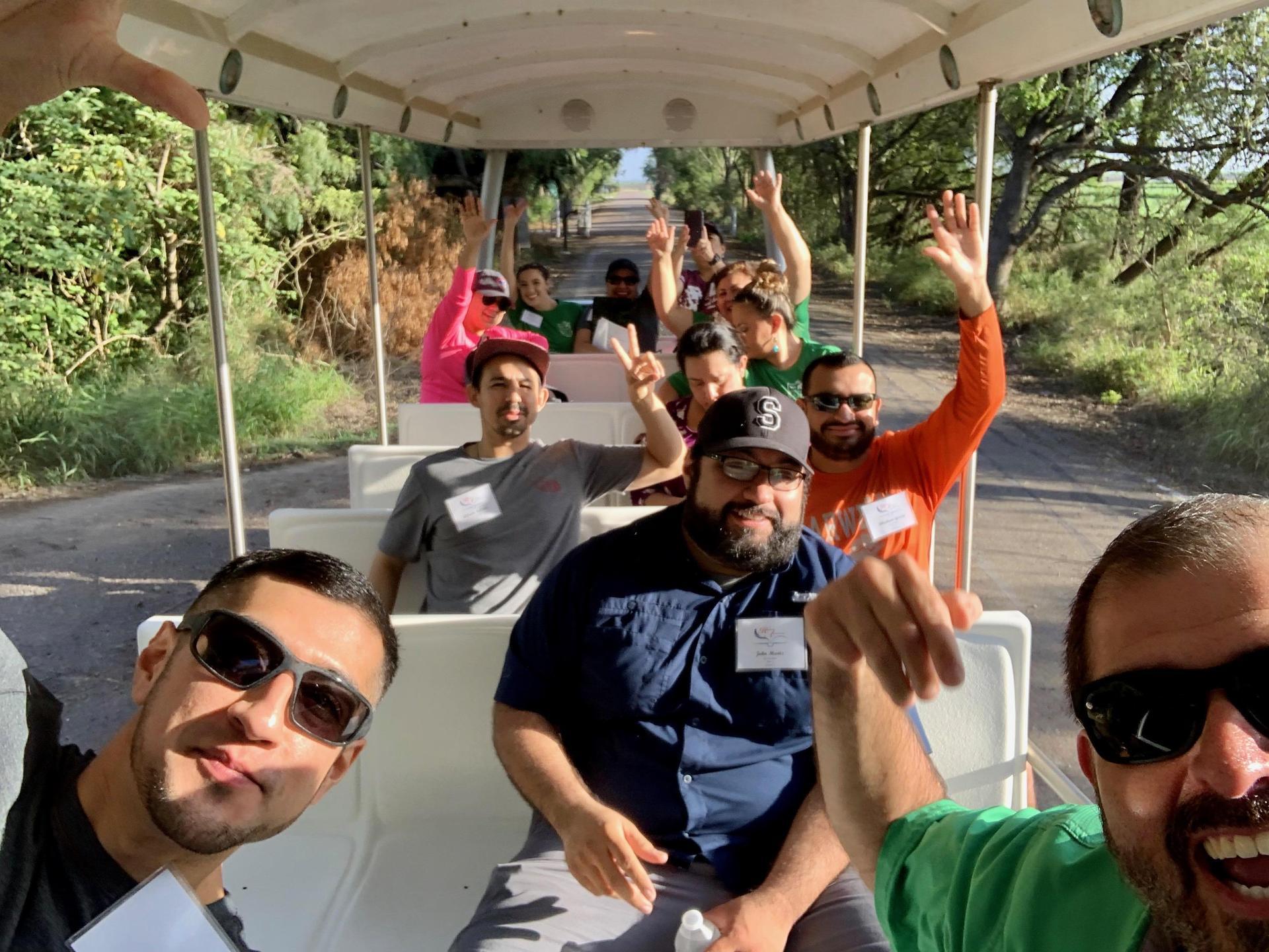 Group photo of teachers on a tour vehicle